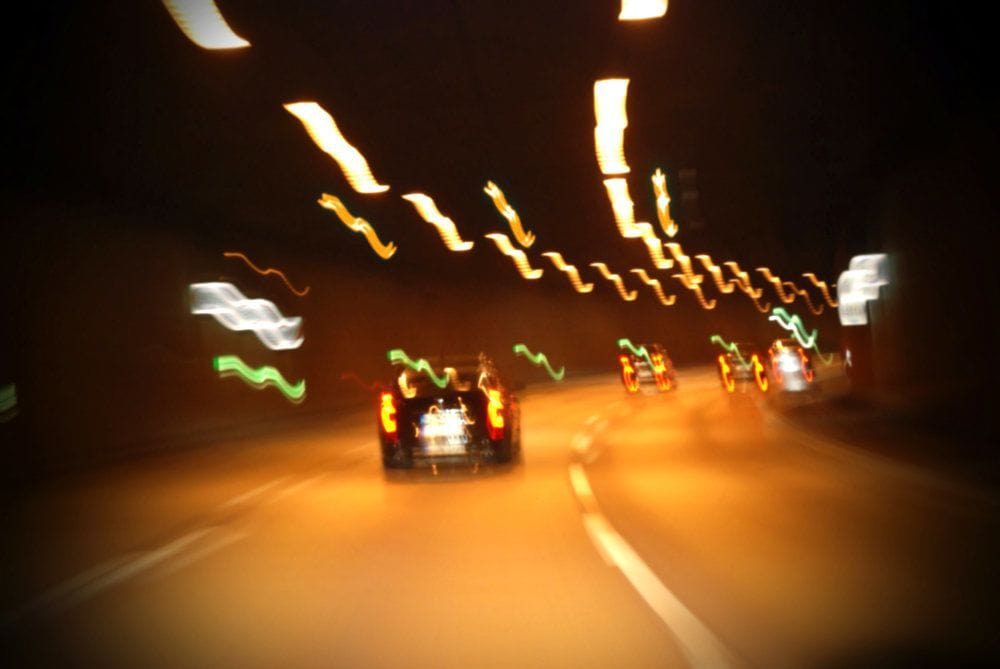 Cars Driving Fast Through A Tunnel.