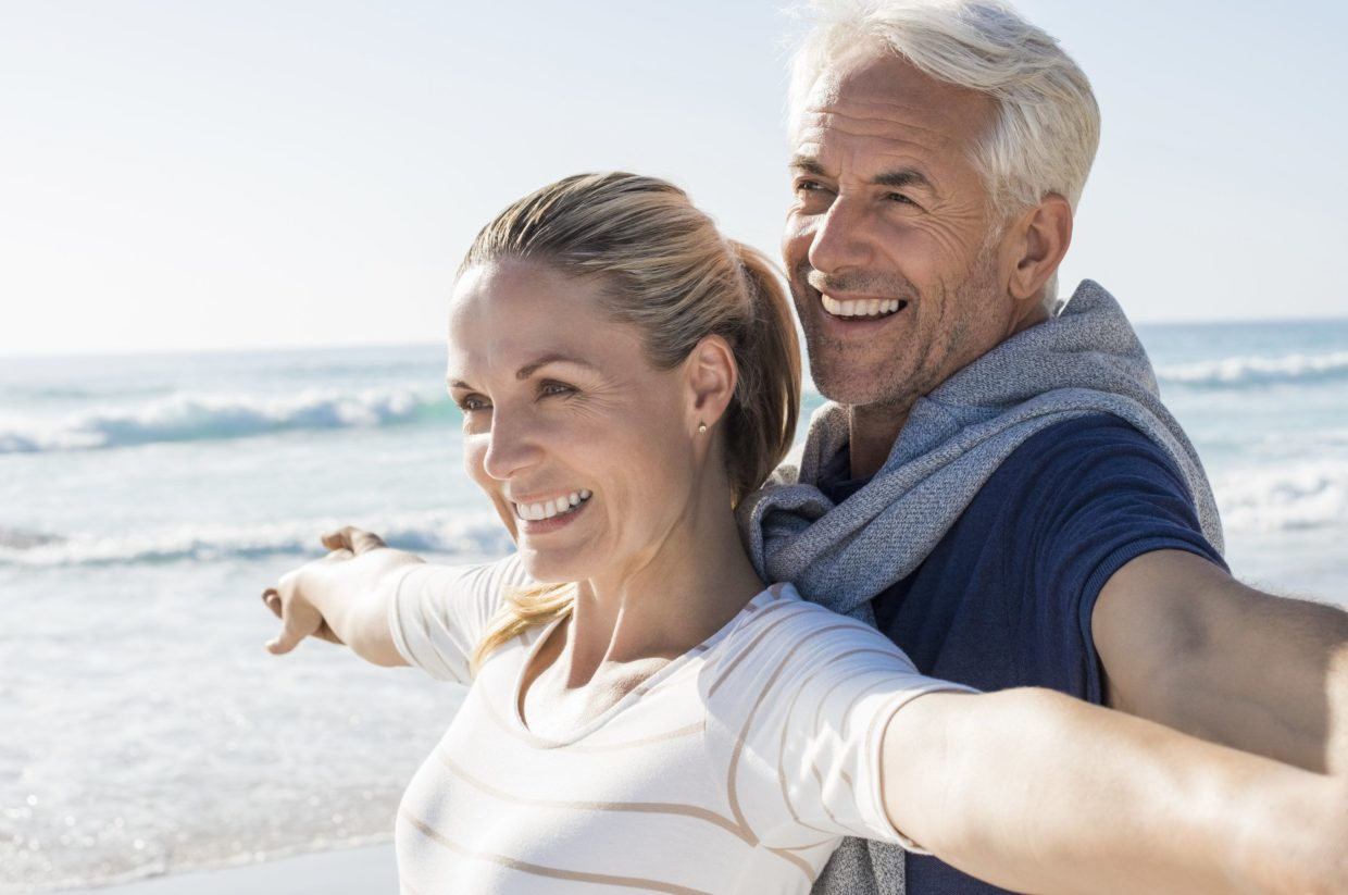 Older Couple Enjoying Time At The Beach.